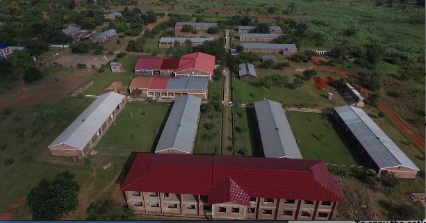 Aerial view of campus showing the Legacy Building, four class blocks, science lab, cafeteria, hostels and teacher houses.