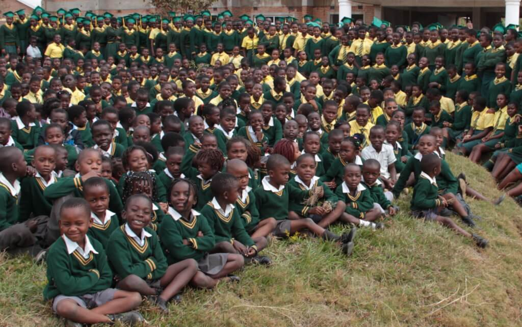 Full school photo shoot taken June 2017 with all primary and secondary teachers. Graduating class of 2017 standing at the back.